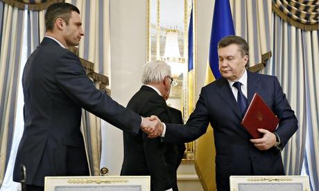 President Yanukovych shakes hands with opposition leader Vitali Klitschko (Photo: The Guardian)