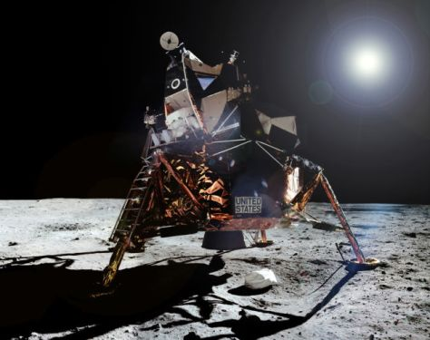 A photo Armstrong took of Aldrin exiting the Eagle. Click to enlarge