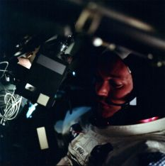 Mike Collins, who piloted the command module, and a floating camera (Photo: NASA/Project Apollo Archive)
