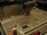 """""""Using plywood, make a mock tub in the car's interior. Try not to glue your fingers together more than fifteen times."""""""