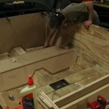 """Using plywood, make a mock tub in the car's interior. Try not to glue your fingers together more than fifteen times."""